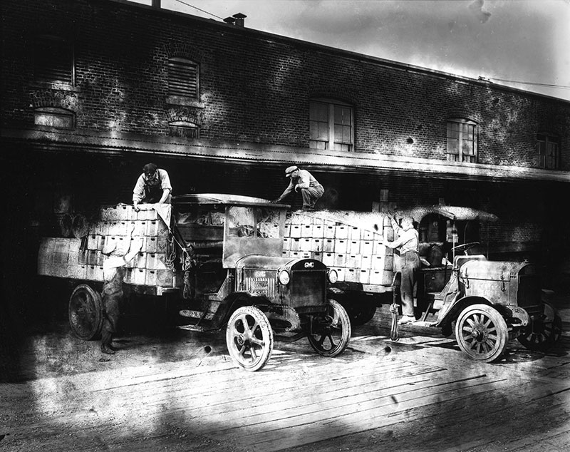 Workers loading trucks for Vancouver Breweries, 1923. City of Vancouver Archives #99-1404