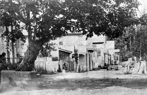 history prostitution Water Street around 1880. The settlement was still called Granville, or Gastown after Gassy Jack, whose saloon is on the far left. This is where Birdie Stewart set up the town's first known brothel in 1873. Photo by Joseph Davis, City of Vancouver Archives #Dist P11.1