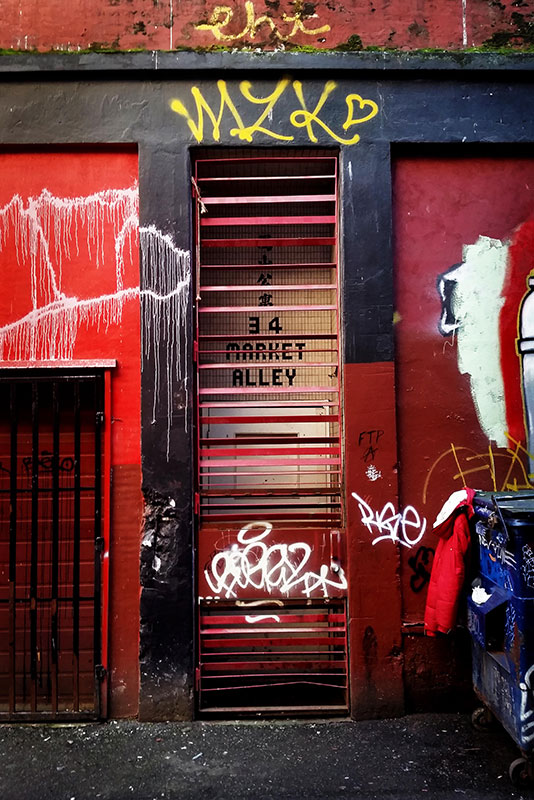 This sign for 34 Market Alley is the only surviving indication that this was once a bustling commercial laneway.