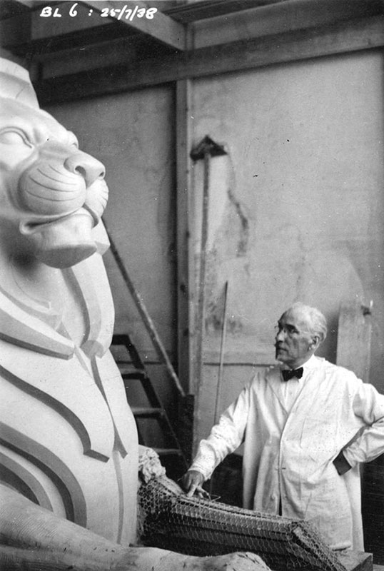 Sculptor Charles Marega with one of the lions he made for the Lion's Gate Bridge in 1938. Photo by AC Kelly, City of Vancouver Archives #1399-400