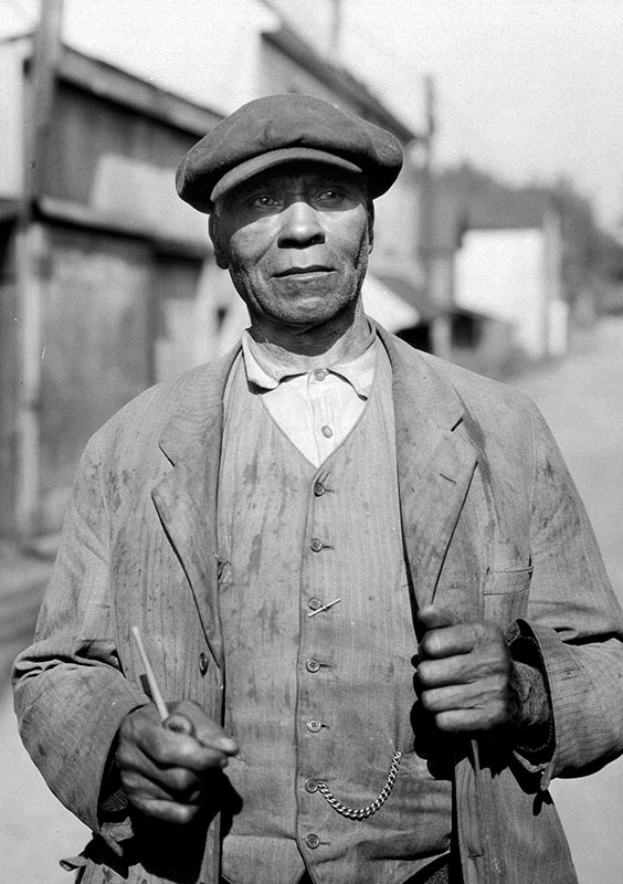 Fielding William Spotts came to British Columbia with the first wave of black immigrants from California in the 19th century. Here he is in Hogan's Alley in 1935, at the age of 78, when he lived at 217 1/2 Hogan's Alley. City of Vancouver Archives #Port N3.1.