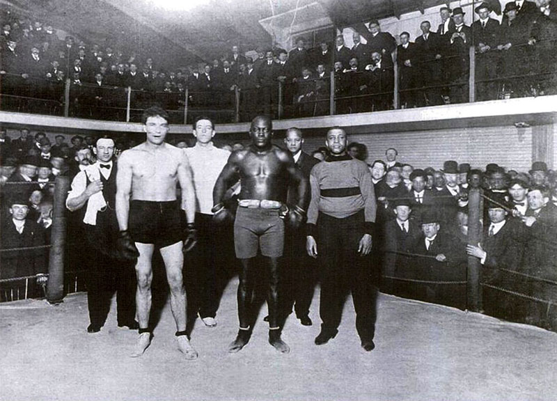 Jack Johnson's first fight after becoming the first black heavyweight boxing champion of the world was a demonstration match at the Vancouver Athletic Club in Beatty Lane. He beat Victor MacLaglan, who later found more success as a Hollywood actor. On Johnson's right is George Paris, manager of the club. Photo courtesy Heritage House.