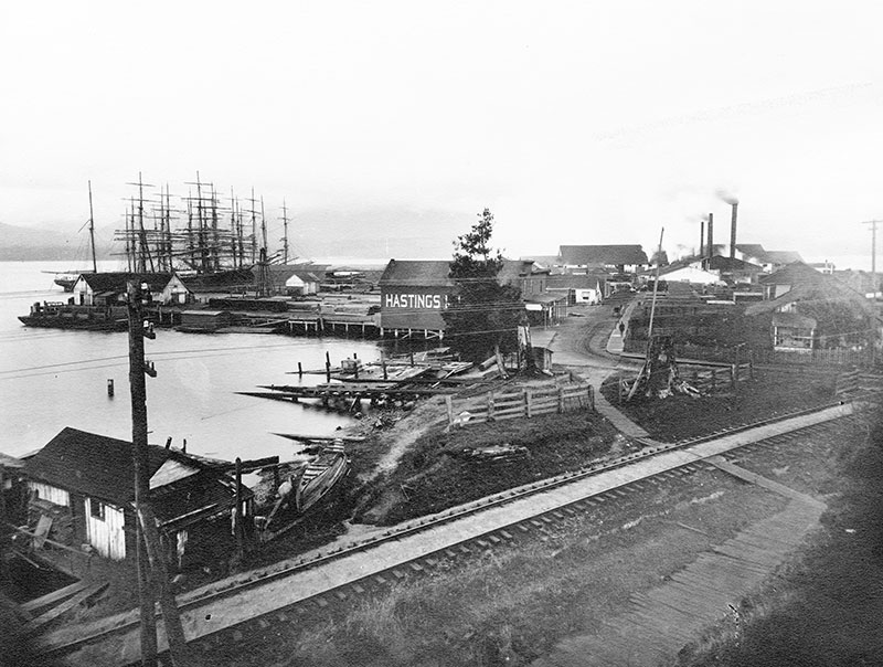 """Hastings Mill from the foot of Gore Avenue, 1888. The mill's """"dry"""" policy inspired Gassy Jack to open a saloon in what became Gastown. City of Vancouver Archives #Mi P21"""