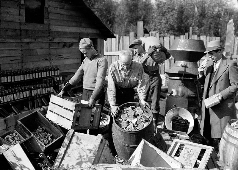RCMP seizure of a still on the Musqueam Reserve, 1932. Photo by Stuart Thomson, City of Vancouver Archives #99-4266.