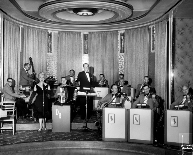 The Dal Richards Orchestra at the Panorama Room in the Hotel Vancouver. Richards led the orchestra from the 1940s, when mixing music, dancing, and alcohol was still taboo in Vancouver. Photo by Franz Lindner, May 1960, for the CBC.