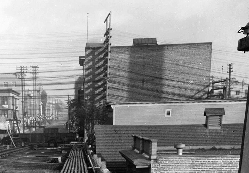 Looking east toward Main Street during construction of the first Georgia Viaduct around 1914. The large building is the rear of the Avenue Theatre and just below it is the top of the Lincoln Club. City of Vancouver Archives #LGN 1188 (cropped)
