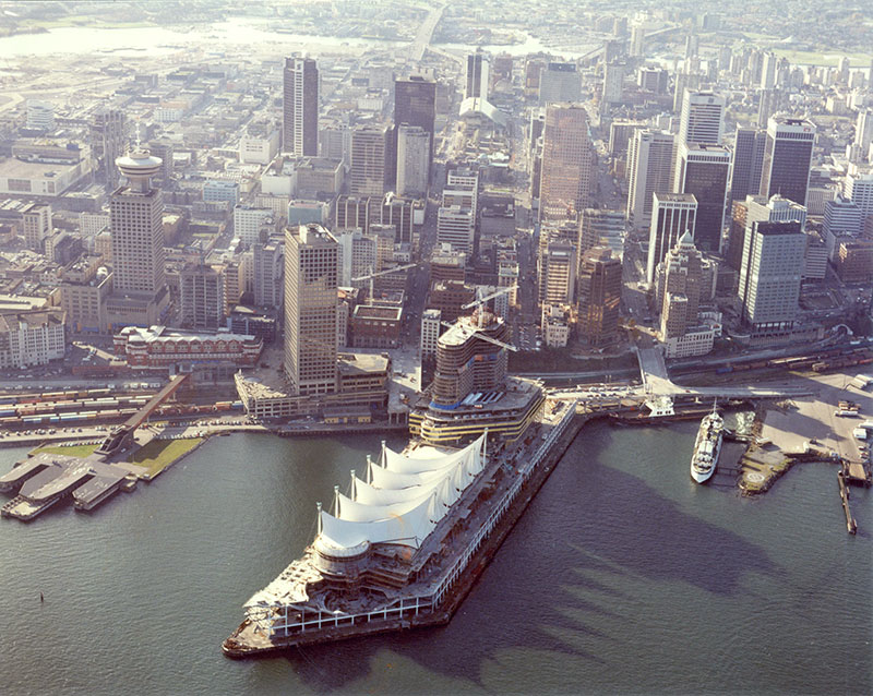 Downtown Vancouver as the city was scrambling to get ready for Expo 86. Canada Place was under construction, and the Marine Building was now dwarfed by lesser office towers. City of Vancouver Archives #1376-511.
