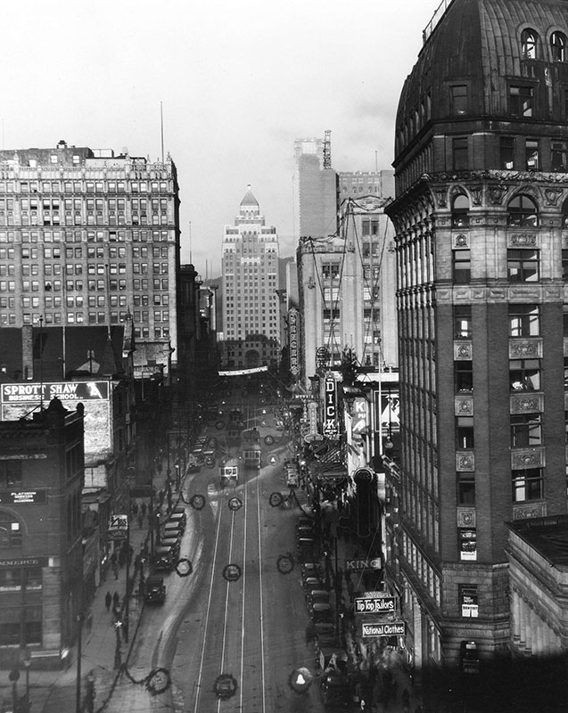Looking down West Hastings from Cambie Street. in 1930. Photo by Leonard Frank, City of Vancouver Archives #Str P20.